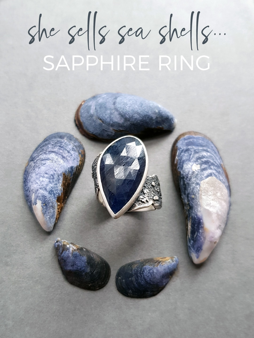 blue sapphire ring in textured silver resembling sea shells