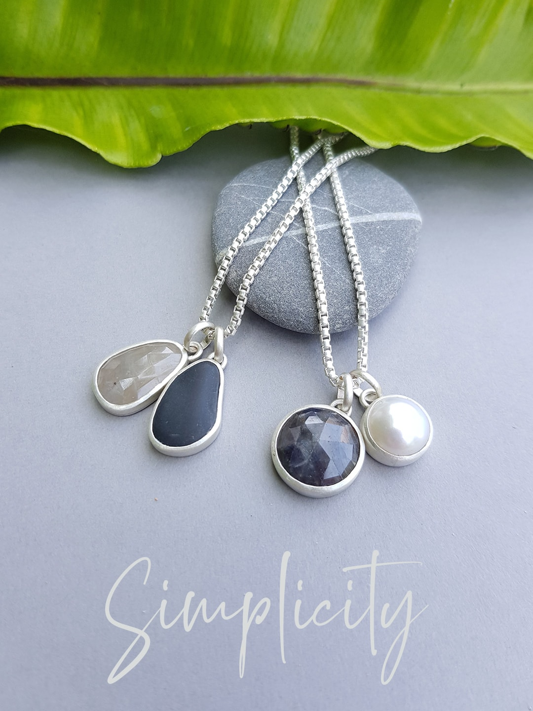Simplicity pendants with pebbles and sapphires