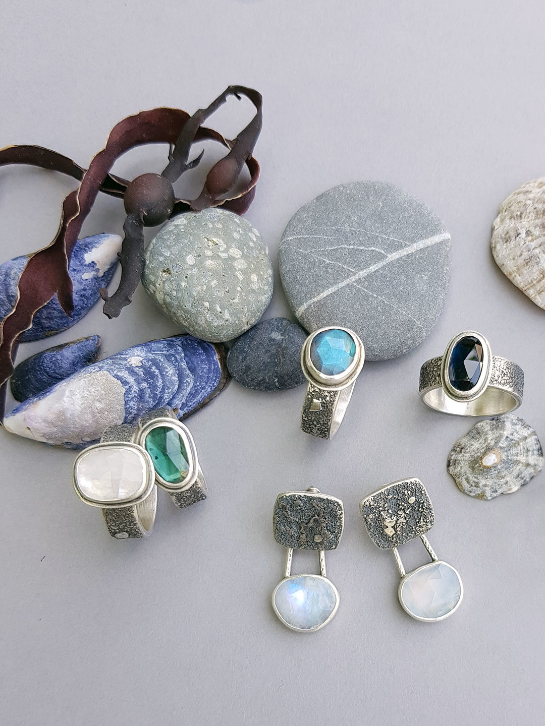Rugged collection rings; blue gemstone and textured silver rings