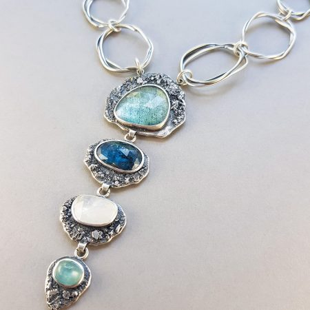 Statement necklace with aquamarine, kyanite, rainbow moonstone and blue tourmaline