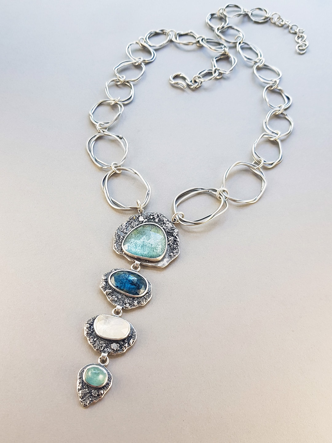 Statement necklace with gemstones and handmade chain