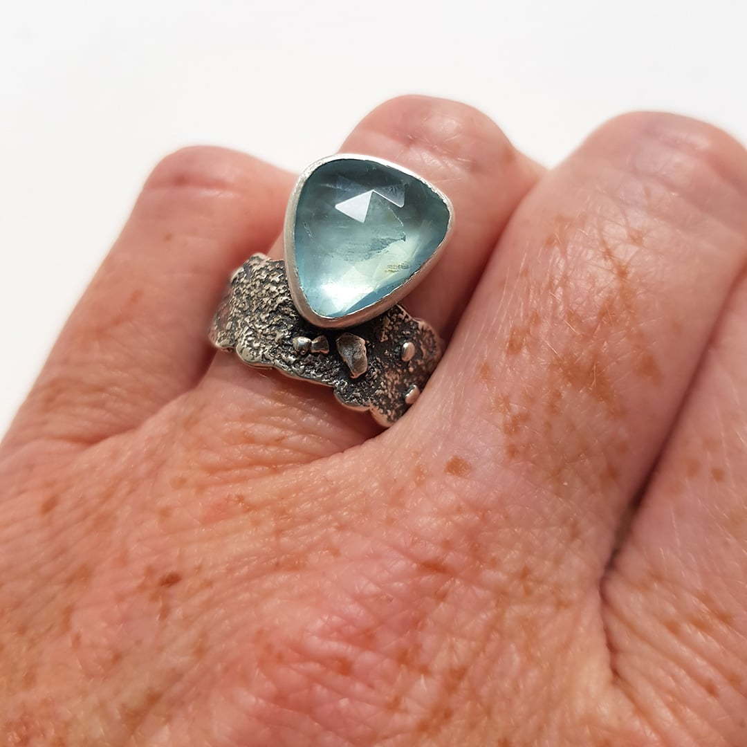 Pale blue aquamarine ring in textured sterling silver
