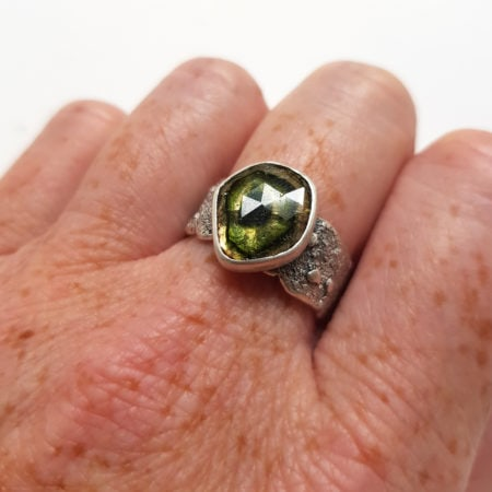Green and brown tourmaline ring in textured sterling silver