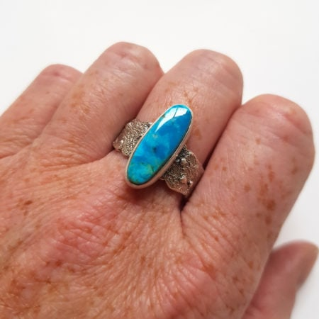 American blue turquoise ring in sterling silver with texture