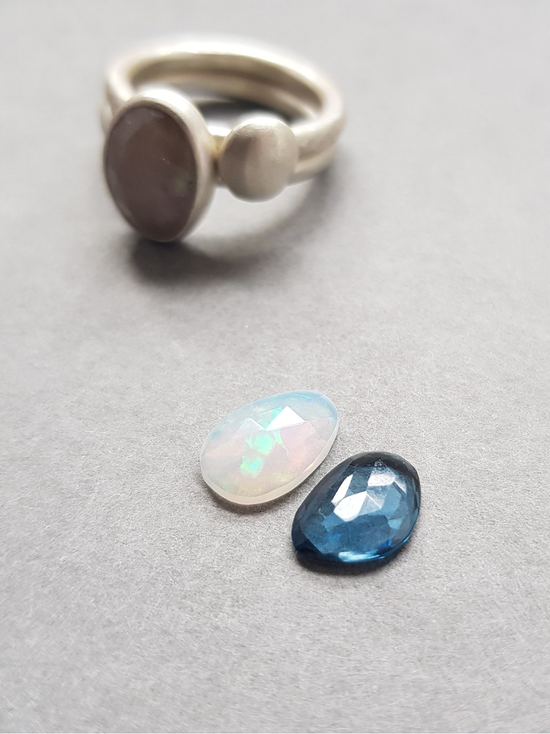 White opal and blue topaz rings