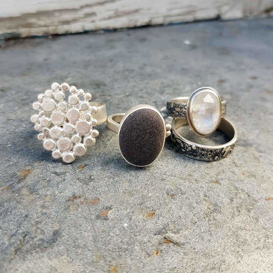 Handmade rings in sterling silver, beach pebble and rainbow moonstone