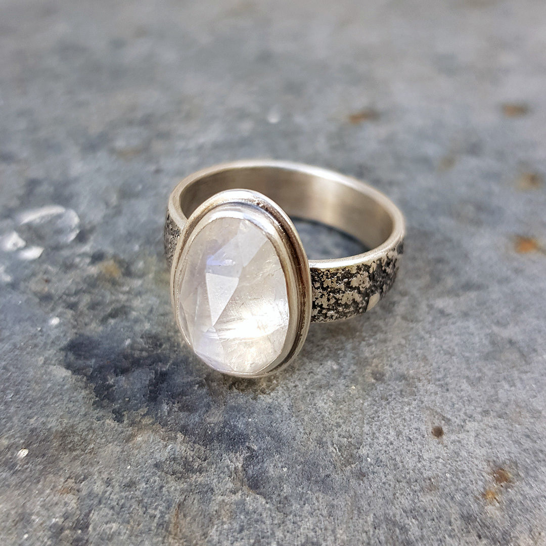 Rainbow moonstone ring in textured sterling silver
