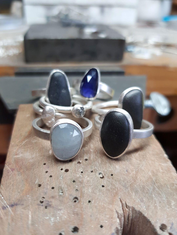 pebble, sapphire, iolite and diamond rings in progress