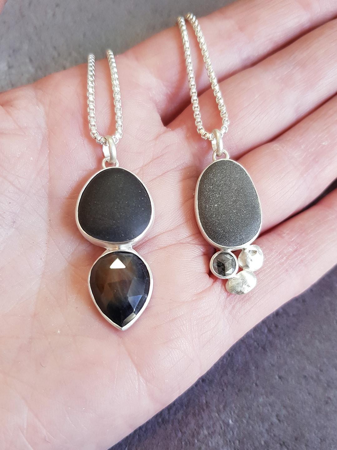 Pebble pendants with diamond and sapphire