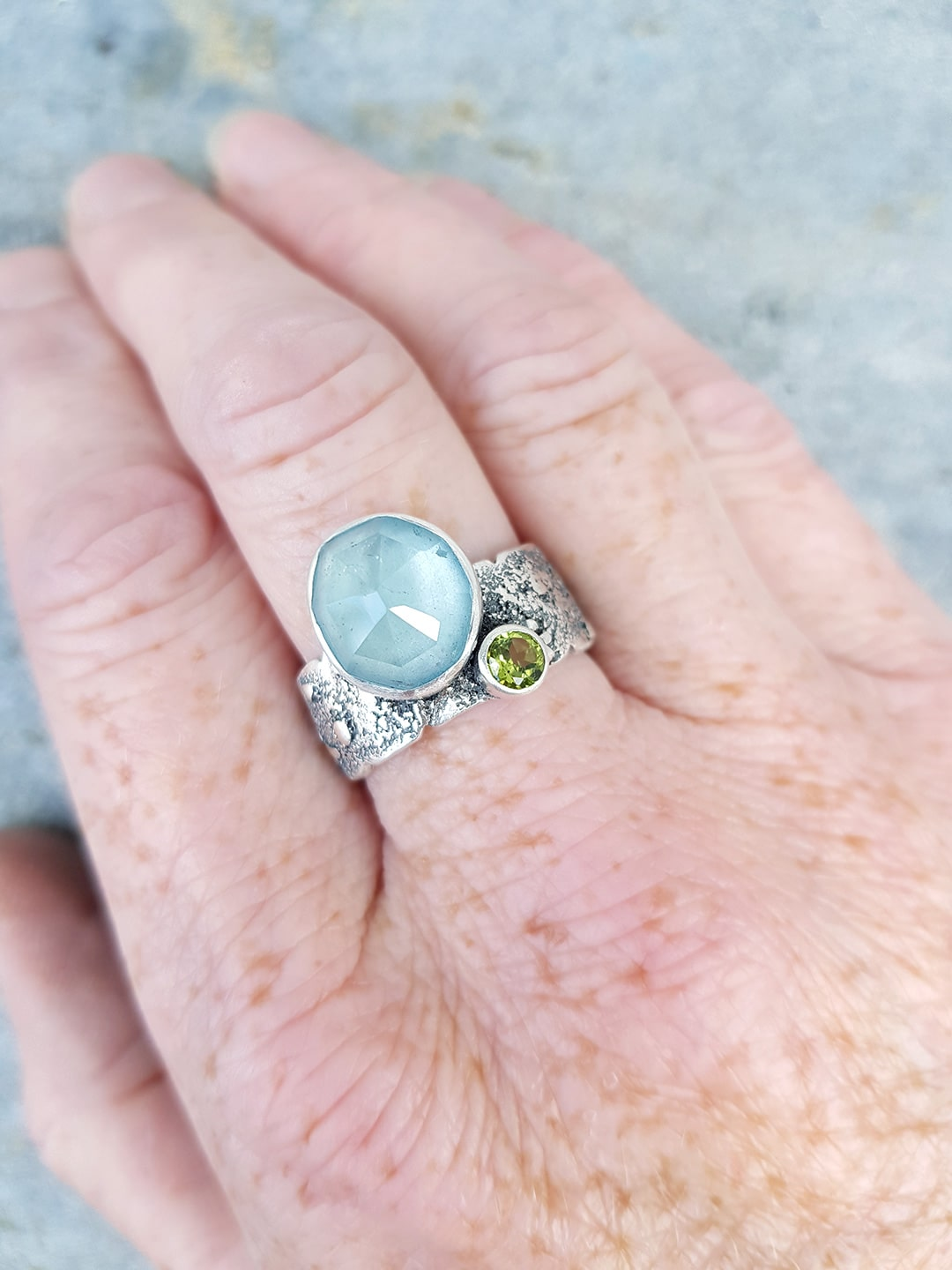 Wearing handmade aquamarine ring in textured sterling silver