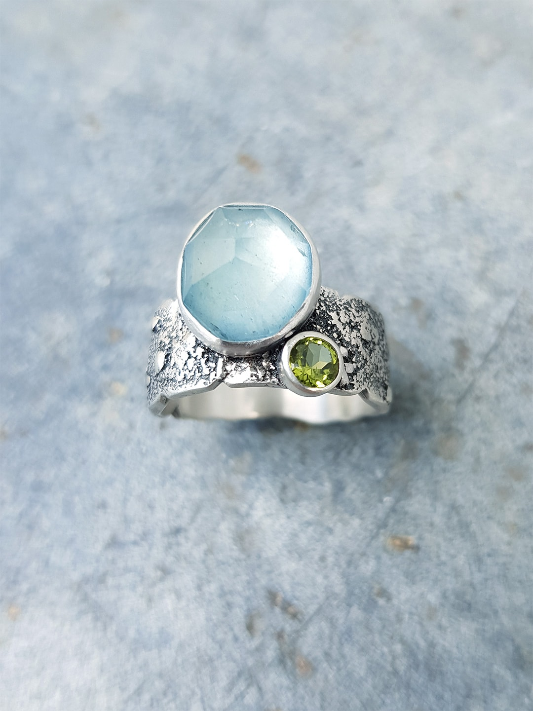 Textured silver ring with aquamarine and peridot