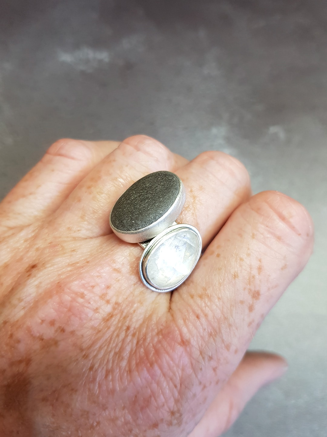 Rainbow moonstone rugged ring and pebble ring stacked up