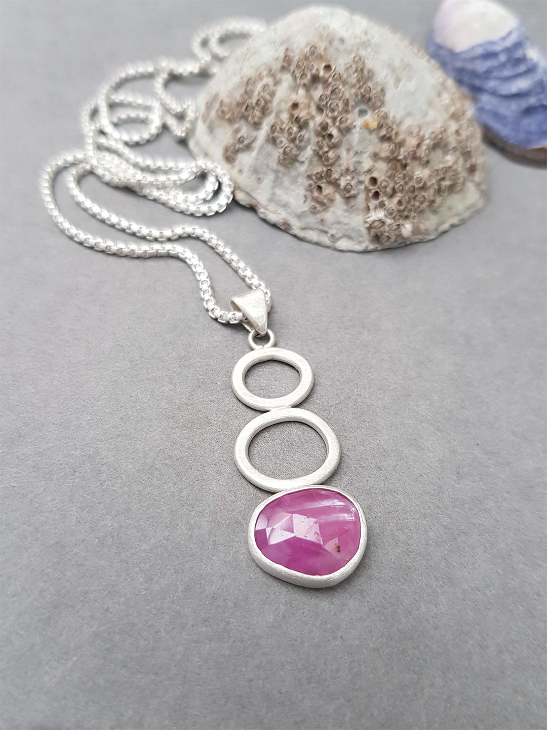 Pink sapphire pendant in brushed sterling silver