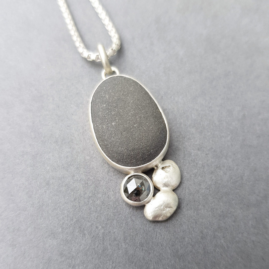 Beach pebble, diamond and silver pebble pendant