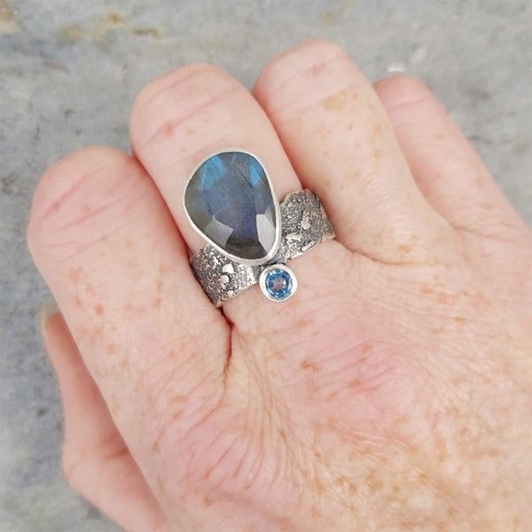 Wearing Labradorite and Swiss blue topaz ring in textured sterling silver