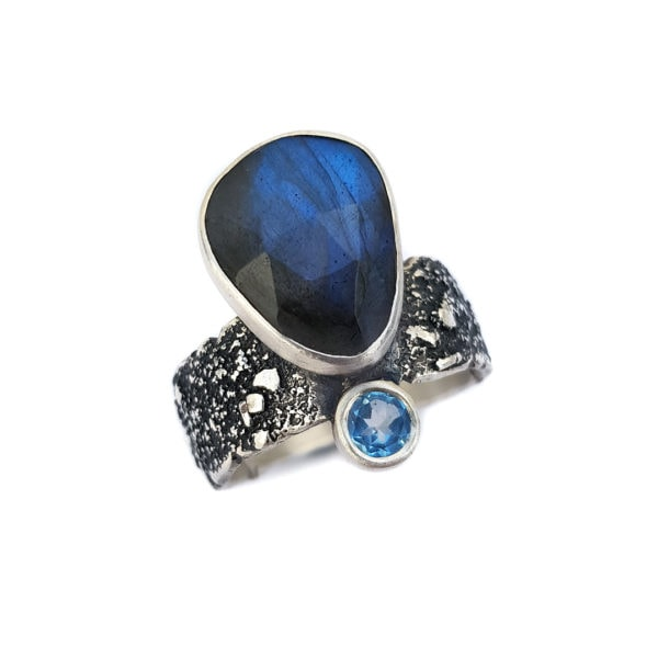 Labradorite and Swiss blue topaz ring in textured sterling silver on white background