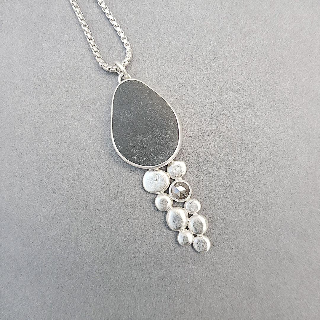 Cornish beach pebble, grey diamond and sterling silver pendant