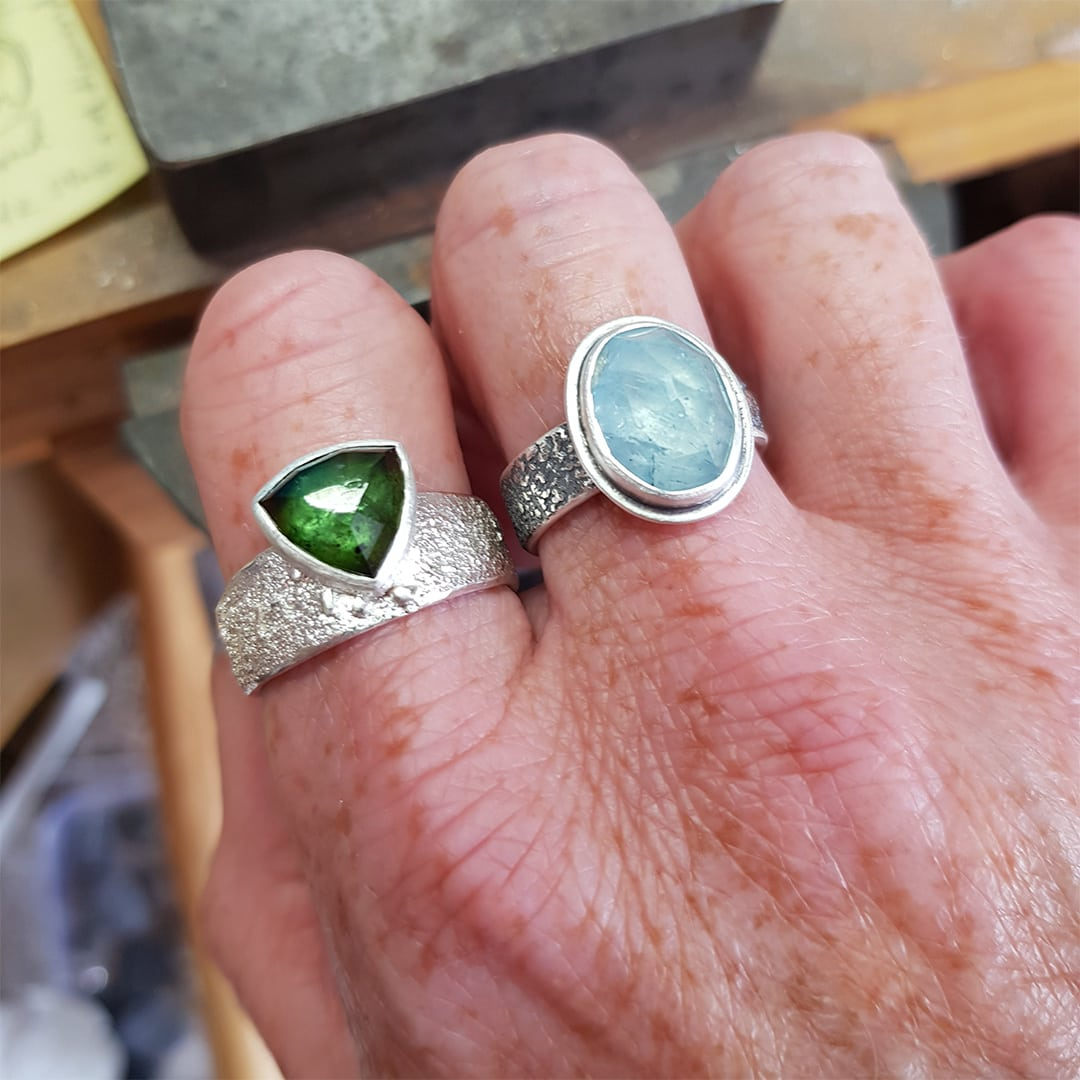 Rugged collection rings just finished, shown on hand