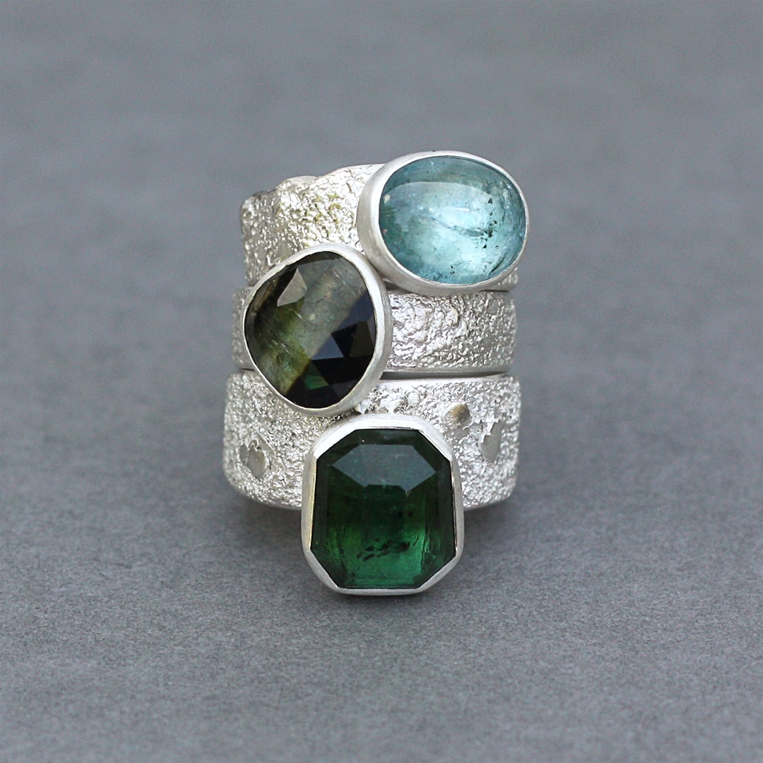 Stack of green and blue Tourmaline rings in silver