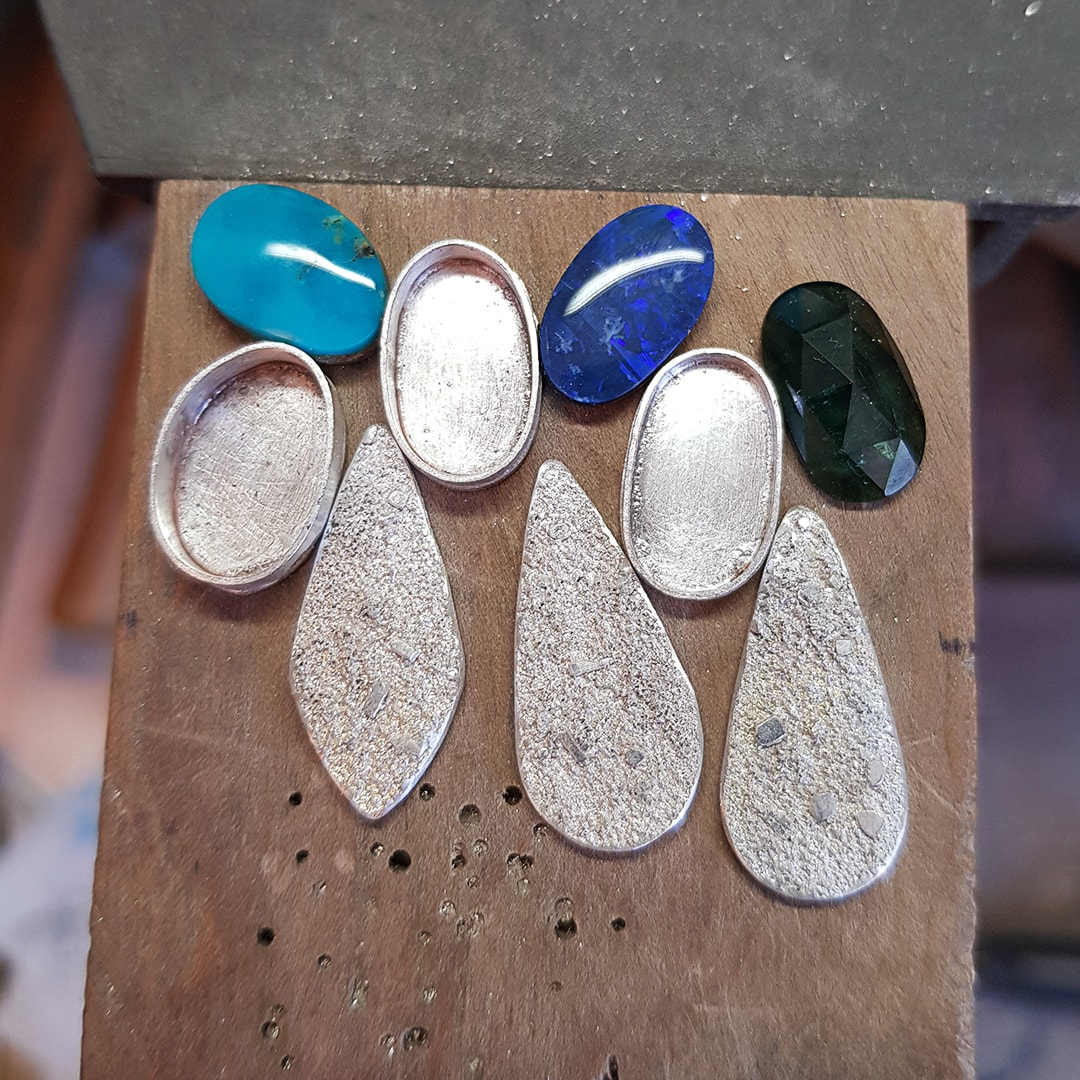 Turquoise, Opal and Tourmaline pendants on the bench