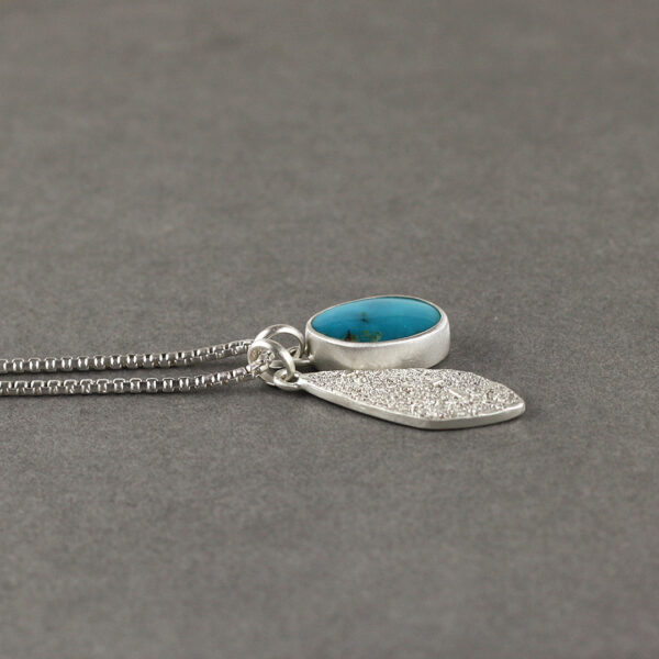 Duo of turquoise and silver pendants