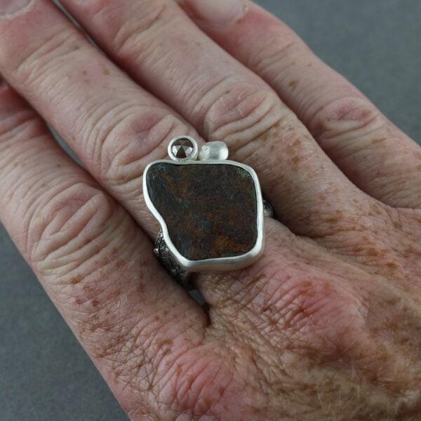 Handmade ring with beach rock and diamond, on hand
