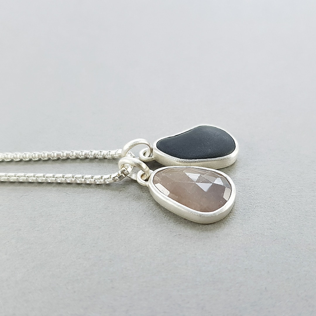 Beach pebble and sapphire pendants in recycled sterling silver