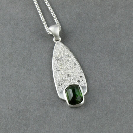 Green tourmaline and textured silver pendant