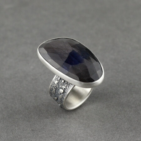 Blue grey Sapphire ring in textured sterling silver