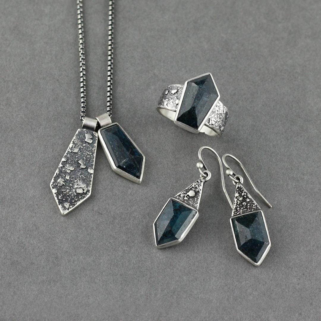 Set in textured silver with geometric cut Kyanite gemstone