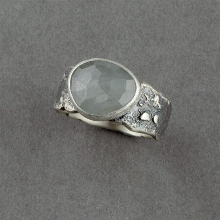 Silver grey sapphire ring in textured, recycled sterling silver