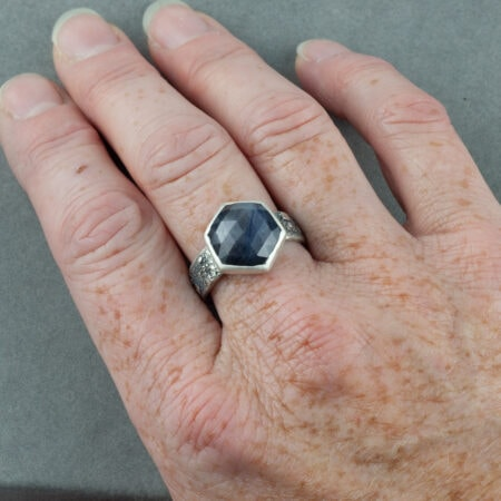 Silky grey geometric cut sapphire ring in recycled sterling silver shown on hand