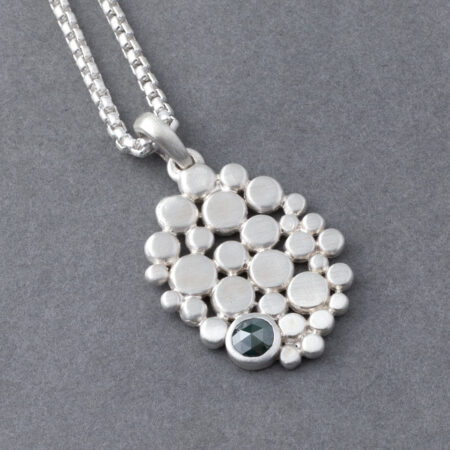 Blue diamond pendant with sterling silver pebble cluster