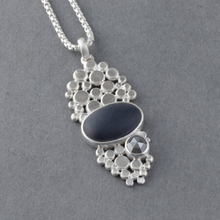 Beach pebble and diamond pendant