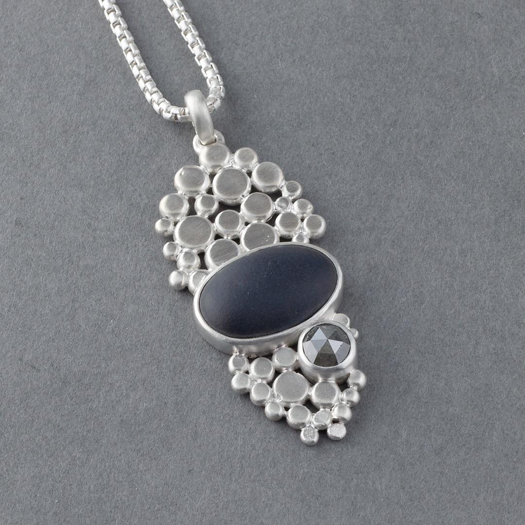 Beach pebble, grey diamond and multi silver pebble pendant