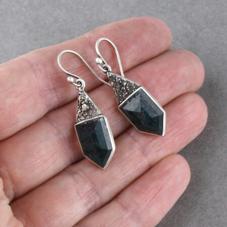 Teal blue kyanite earrings in hand