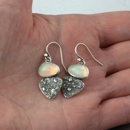 Ethiopian opal earrings in textures sterling silver in hand