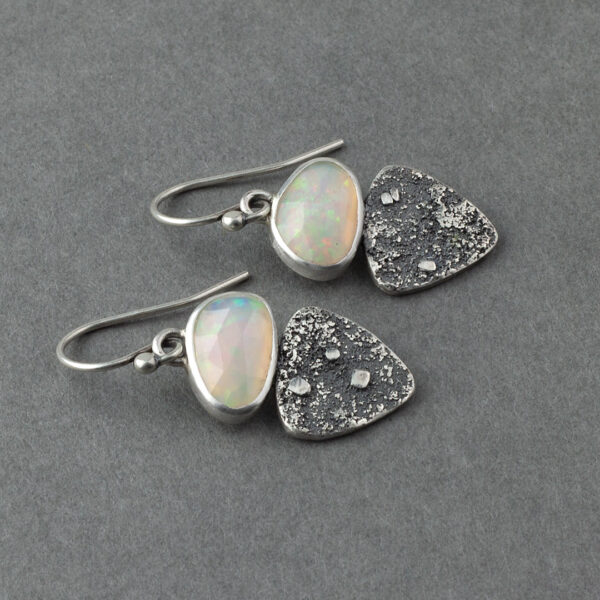 Side view of Ethiopian opal earrings in textures sterling silver