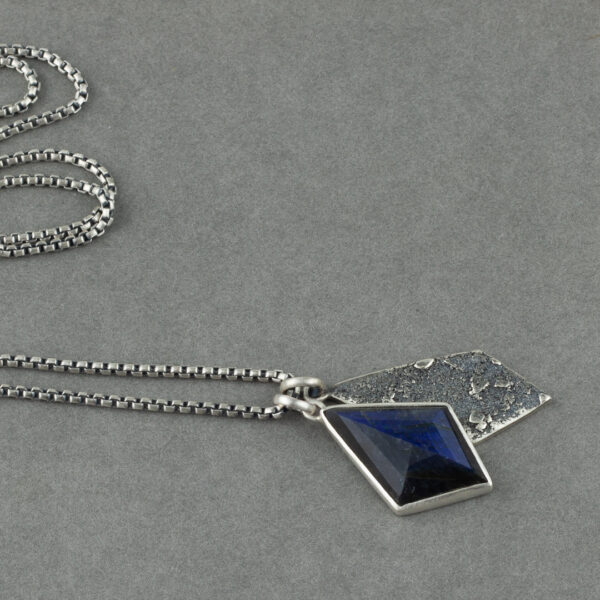 Labradorite and textured recycled sterling silver pendant duo in hand