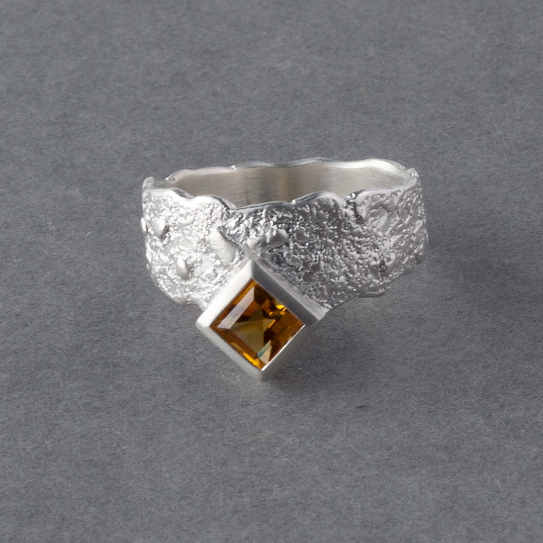 Golden citrine and textured sterling silver ring
