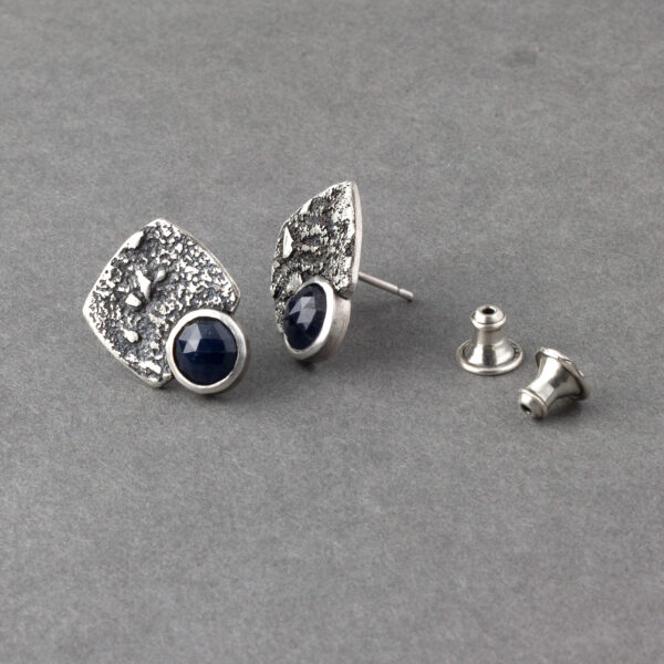Showing clutches for blue sapphire stud earrings in textured sterling silver
