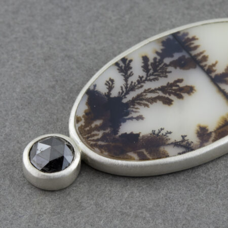 Closeup of dendritic agate pendant