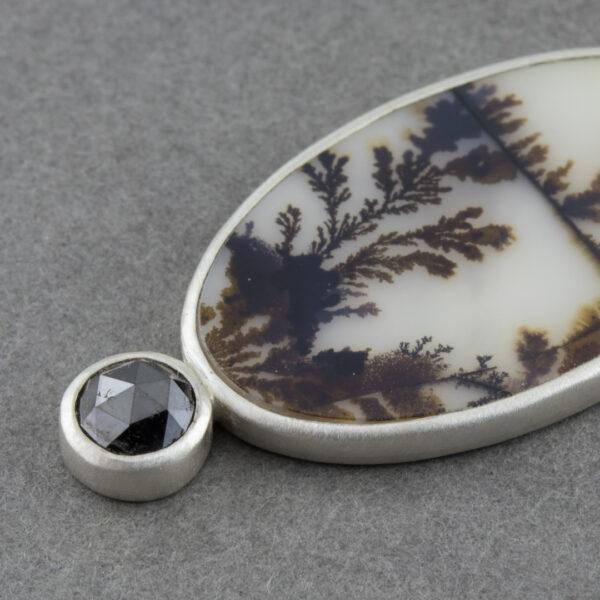 Closeup of dendritic agate pendant