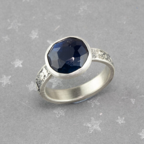 Dark blue tourmaline ring in textured recycled sterling silver