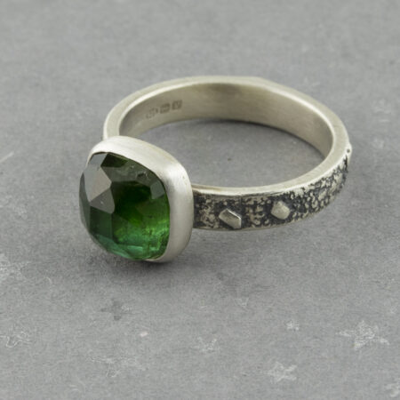 Moss green tourmaline ring in textured sterling silver