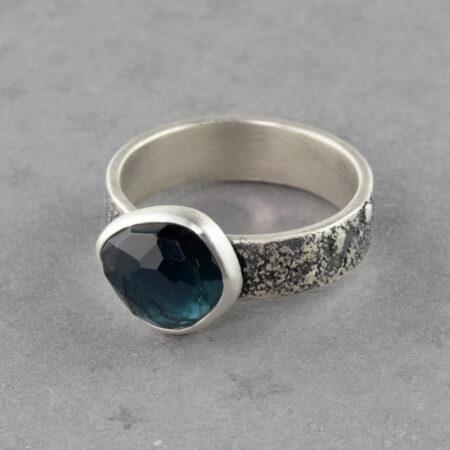 Handmade teal blue tourmaline ring in textured sterling silver