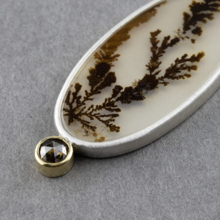 Closeup of 18ct gold set brown rose cut diamond on Dendritic agate pendant