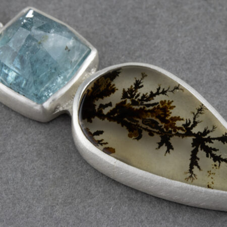 Detail of Dendritic agate and blue tourmaline pendant