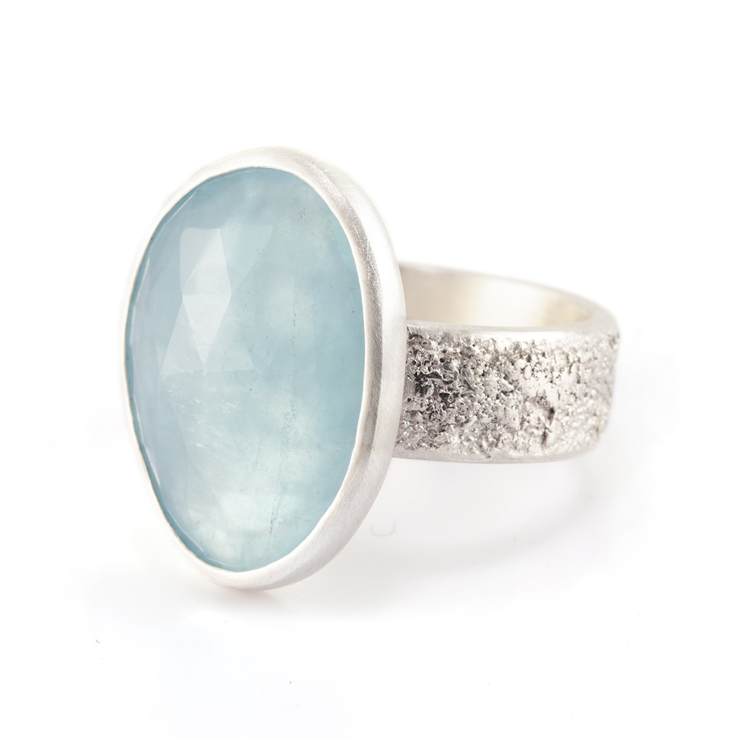 Pale blue aquamarine ring in recycled textured sterling silver