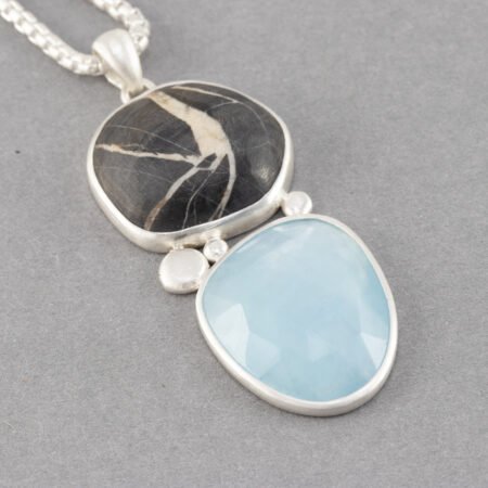 Aquamarine and beach pebble pendant in brushed recycled sterling silver